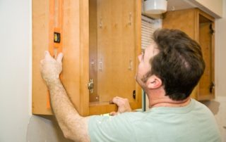 carpenter adjusting cabinet
